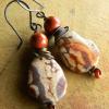 Natural rhyolite and red jasper beaded earrings by Gloria Ewing.