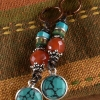 Colorful tribal mix of beads with turquoise by Gloria Ewing.