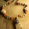 Knotted bead long necklace design by Gloria Ewing.