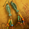 Fun and funky fish skeleton earrings with fringe by Gloria Ewing.