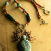 Artisan ceramic goddess beaded necklace by Gloria Ewing.
