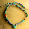 A mix of African beads with green turquoise by Gloria Ewing.
