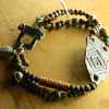 Two strand beaded bracelet by Gloria Ewing, with artisan focal.
