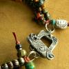 Asymmetrical tribal style bracelet by Gloria Ewing.