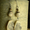 Natural earthenware cave drawing earrings.