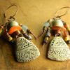 Ancient looking ceramic with trade bead dangles by Gloria Ewing.