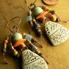 African tribal beaded earrings with artisan ceramic drops.