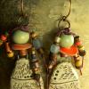 Aged look in ceramic beaded earrings by Gloria Ewing.