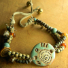 Tribal beaded bracelet with artisan focal piece.