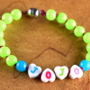 Acrylic beaded bracelet with magnetic clasp by Gloria Ewing.