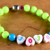 Colorful beaded name bracelet for girls or boys by Gloria Ewing.