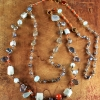 Beaded gemstone necklace in silver and gold by Gloria Ewing.