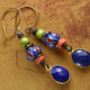Trade beads with lapis lazuli in earrings by Gloria Ewing.