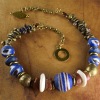Lapis lazuli and African brass and glass by Gloria Ewing.