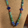 Colorful beaded necklace with lapis lazuli pendant by Gloria Ewing.