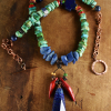 Lapis blended with turquoise and coral, necklace design by Gloria Ewing.