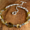 Faceted lemon quartz and Bali style Sterling silver, design by Gloria Ewing.