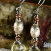 Contrast of old and new in topaz and mixed metal earrings by Gloria Ewing.