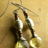 Gorgeous faceted yellow topaz with rustic African metal by Gloria Ewing.