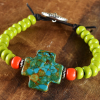 Mosaic turquoise beaded leather bracelet by Gloria Ewing.