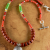 Medallion pendant necklace with bright colorful beads by Gloria Ewing.