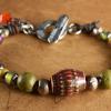 Retro mood beads with Mykonos ceramic by Gloria Ewing.