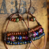 Richly colored bead woven hoop earrings by Gloria Ewing.