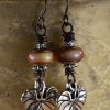 Pewter leaf charms and mood beads in earrings by Gloria Ewing.