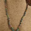 Mykonos lotus pendant with Czech seed beads by Gloria Ewing.