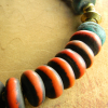 Old trade beads and amber is a choker design by Gloria Ewing.
