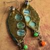 Mixed metals and colorful trade bead dangles by Gloria Ewing.
