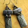 Purple dormutierite earrings by Gloria Ewing.