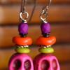 Teen beaded earrings with pink magnesite skulls by Gloria Ewing.