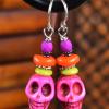 Pink beaded skull earrings for Halloween by Gloria Ewing.