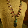 Red jasper with a tribal focal pendant by Gloria Ewing.
