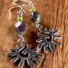 Striking spiral sun beaded earring design by Gloria Ewing.