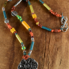 Sun pendant beaded necklace for teen girls by Gloria Ewing.