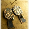 Hand forged copper earrings by Gloria Ewing.