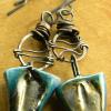 Primitive wire wrap copper earrings by Gloria Ewing.