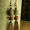 Green and rust colors in a rustic beaded earring design by Gloria Ewing.