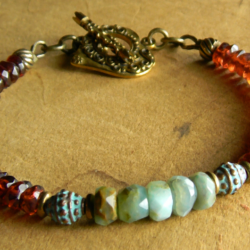 Beaded bracelet with garnet and opal by Gloria Ewing.