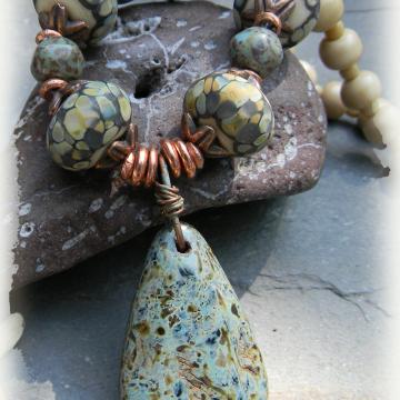Smokey blue lampwork beads in a southwestern necklace.