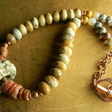 Beaded necklace with fossil pendant by Gloria Ewing.