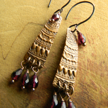Garnet earrings with rich copper in a design by Gloria Ewing.
