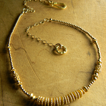 Boho style beaded gold choker necklace by Gloria Ewing.