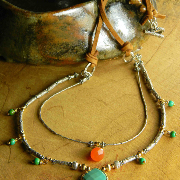 Green turquoise and carnelian in a multi-strand design.