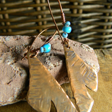 Hammered copper earrings by Gloria Ewing.