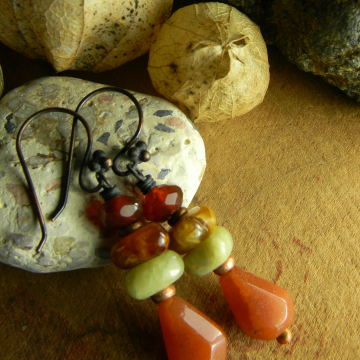Shades of jade mixed with carnelian in earrings by Gloria Ewing.