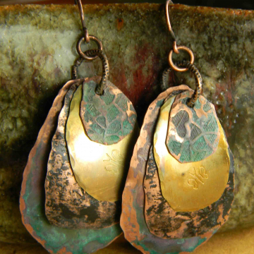 Hand forged butterfly wing earring design by Gloria Ewing.