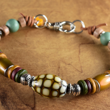 Counter culture mood beads on leather bracelet by Gloria Ewing.